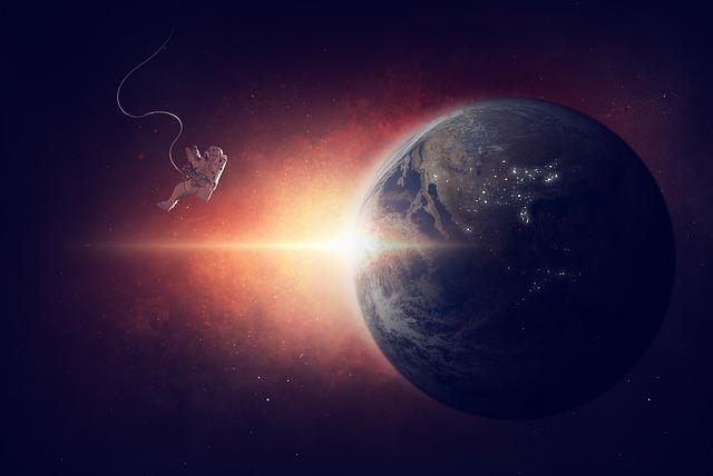 地球と無重力状態にいる宇宙飛行士